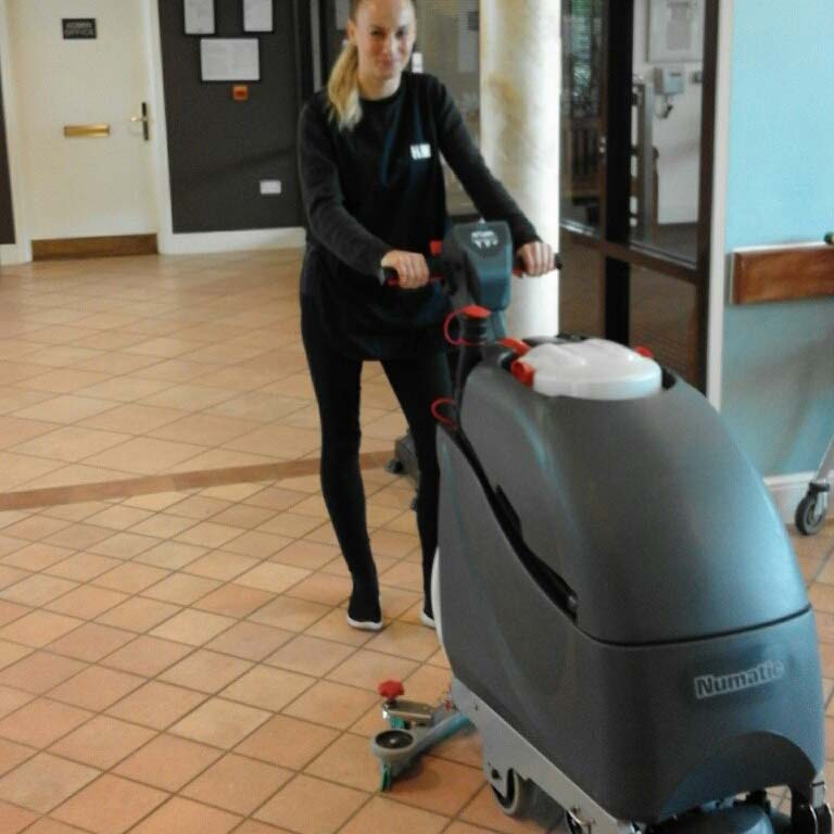 about heath & wiltshire - H&W Staff cleaning a tiled floor - Hampshire services available