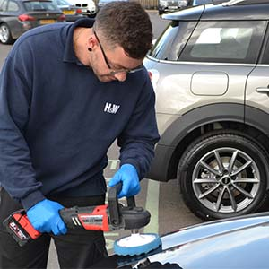 Car Valeting - A member of H&W staff valeting a silver BMW car - commercial valeting cleaning services - available in Gloucestershire & more