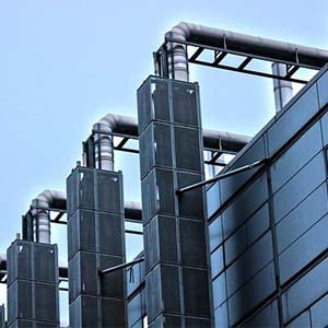 Cleaning Services - An image of a large factory building.